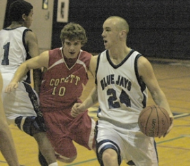 by: David Ball, Portland Lutheran guard Michael Covelle dribbles past Corbett's Zach Soulagnet during the Blue Jays' 61-45 win Tuesday night.