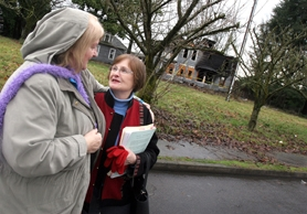 by: Jaime Valdez, SCORCHED HISTORY – Tualatin Historical Society members Yvonne Addington (left) and Loyce Martinazzi commiserate with one another after a fire destroyed the 103-year-old Nyberg House last week.