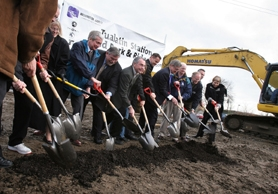 by: Jaime Valdez, LATE, BUT ON TRACK — Officials from Washington County, the city of Tualatin and TriMet dig into the site of the future Tualatin commuter rail station during the groundbreaking ceremony Wednesday.