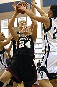 by: MILES VANCE, REBOUNDERS — Southridge seniors Brittany Santucci (front) and Michelle Jenkins battle for a rebound in their team's Tuesday loss to Skyview in Vancouver, Wash.
