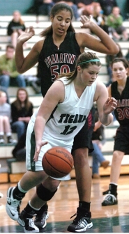 by: DAN BROOD, STANDING TALL — Tualatin sophomore Aly Brown (50) looms above Tigard sophomore Chelsea Biglow during Friday's game.