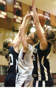 by: DAN BROOD, TRAPPED — Sherwood junior post Lauren Codling is trapped between Wilsonville's Katy Britsch (left) and Ashley Walters as she goes up for a shot.