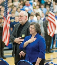 by: Carole Archer, Lance and Mardie Jensen pledge allegiance to the flag at a Barlow High School ceremony honoring their son on Friday, Jan. 11, complete with honor guard, a bagpiper and the Patriot Guard Riders.