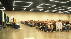 by: contributed photo, Several thousand people filled the Oregon Convention Center to bid in a housing auction billed as the largest in state history.