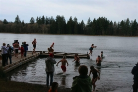 by: Drew Anderson, About 60 people gathered at Roslyn Lake for the farewell Polar Bear Dip there on New Year's Day.