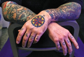 "by: L.E. BASKOW, Mav Mess, who owns Deluxe Tattoo Parlor, is himself well-inked. ""This used to be an industry of just a guy giving a product and getting paid for it, and now it's gone Hollywood,"" he says."