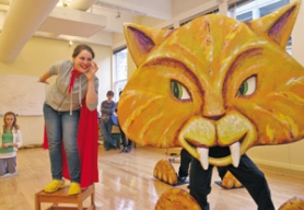 "by: KATIE HARTLEY, Briauna Simmons-Yager, 12, talks to a giant cat during a rehearsal for the Oregon Children's Theatre production of ""Lilly's Purple Plastic Purse."""