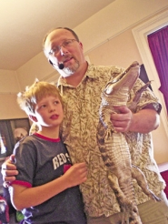 by: ©2008 BETTE VAN BUSKIRK, Reptile Man Richard Ritchey (left) says older people are more likely to be afraid of things that crawl or slither. At 8, Luke (with Ritchey and above) isn't showing any signs yet that he inherited his grandfather's dismay about all things reptilian.