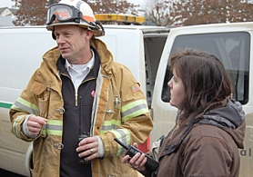 by: Darryl Swan, Columbia River Fire and Rescue Division Chief Brian Burright (left) and St. Helens High School Principal Nanette Hagen manage the scene at the high school, where students, teachers and administrators became ill    and an odor similar to natural gas was detected.