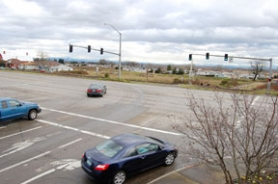 by: Darryl Swan, Motorists pull out from Havlik Road onto Highway 30. The city is seeking a funding source to make rail improvements needed to open an extension of Havlik Road to the city's south end (through traffic light at right). If successful, it would ease traffic and open land to commercial development.