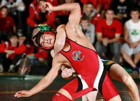 by: Craig Mitchelldyer, Oregon City freshman 130-pound wrestler Zach Wallave attempts to escpae from West Linne freshman Travis Schutzler during a 4-0 win. The Pioneers upended the Lions 40-19.