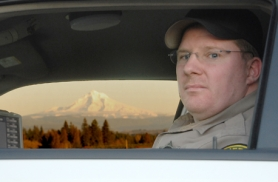 by: Patrick Sherman, Clackamas County Sheriff's Deputy Scott King watches for drivers speeding through the Damascus area on their way to Mt. Hood.
