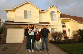by: Jaime Valdez, The Chertude family and their contractor stand in front of the finished project. From left, they are Michelle, Alyssa, Patrick and Payton Chertrude and builder John Sramek of West Linn.