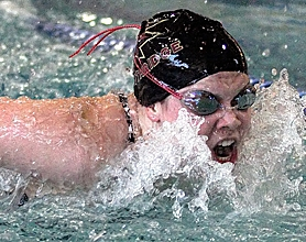 by: MILES VANCE, ON HER WAY — Southridge freshman Taylor Lakey breaks the surface on her way to victory in the 100-yard butterfly against Jesuit last Thursday at Conestoga Swim Center.