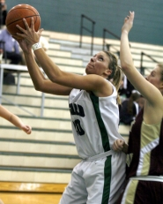 by: JONATHAN HOUSE, UP FOR TWO — Tigard High School senior Brittany Duty goes up to the basket for two of her 13 points in the Tigers' 69-41 victory over Forest Grove on Friday.