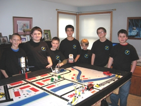 by: Barbara Sherman, GEARING UP FOR BATTLE — Gathered around their play board for one of their last practices before the First Lego League state competition this weekend are members of the Twality Middle School Energy Mizers team. From left are Zac Cummings, Ian Schacter, Michael Murray, Alex Good, Riley Ares, Dylan Good and Alan Haynes.