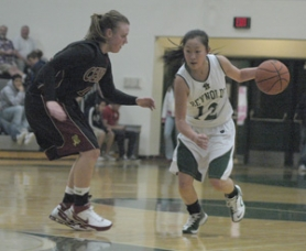 by: David Ball, Reynolds guard Renee Tzeo tries to dribble around Central Catholic's Audrey Miller during the Rams' 62-33 win Friday night.