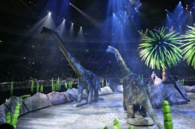 by: Courtesy photo, An adult and young brachiosaurus roam the floor of the Rose Garden as part of the Walking with Dinosaurs show.