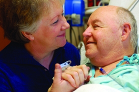 by: Barbara Adams, Richard Stafford of Clackamas shares a moment with his wife, Marj, at Legacy Good Samaritan Hospital in Portland four days after their good friend, Dwight Hires of La Center, Wash., donated Richard a kidney.