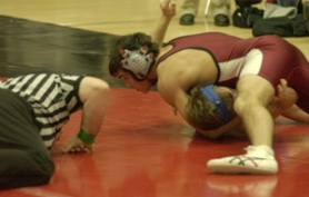 by: Darrell Jackson, Sandy's Matt Rees works for a fall during his win at 152 pounds against Barlow on Thursday.