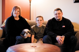 by: Chase Allgood, After seven months, Valerie, Jacob and Joe Colvin  — and their Shih Tsu, Elliot — feel right at home in Forest Grove.