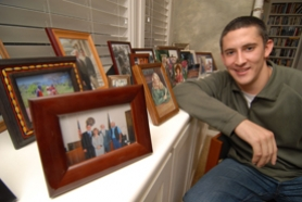 by: Vern Uyetake, Rand Getlin, a West Linn High School graduate and current USC Law School student, shows off family photos at his home in the Barrington Heights neighborhood.