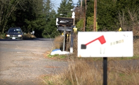 by: Jonathan House, TIME FOR A CHANGE — A car drives along a rural section of 69th Avenue in the Tigard Triangle, which the City Council has included in plans for a local improvement district to improve streets in anticipation of future development that will bring more traffic.