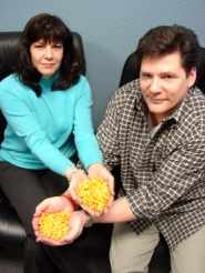 by: Jennifer Clampet, BIG FISH, BIG POND — Michael and Lisa Thayer, owners of GoldfishNet-work.com, hold in their hands their own marketing plan for their Web site design and marketing business — Goldfish crackers.