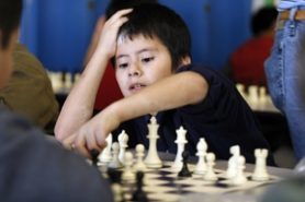 by: JONATHAN HOUSE, William Walker Elementary student Eduardo Zuniga Solano ponders his next move during the beginner-level chess club that meets at the school twice a week.