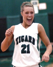 by: DAN BROOD, WINNING SMILE — Tigard senior Heidi Pizer is all smiles following the Tigers' victory over Tualatin.