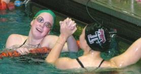by: DAN BROOD, NICE RACE — Tigard High School junior Melissa Myers (left) and Tualatin senior Hannah Points congratulate each other following the 100-yard breaststroke race at last week's Pacific Conference dual meet.