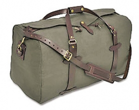 by: , A Filson duffel beats a rigid box on wheels any day.