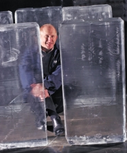 by: JIM CLARK, Jim Porcelli poses with a few of Koldkist's 300-pound blocks of ice. There's a trick, he says, to making them clear when they freeze.