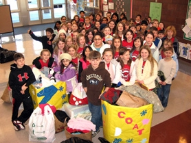 by: Barbara Sherman, MAKING A DIFFERENCE — Alberta Rider Elementary's Ambassadors, some wearing their own coats to promote their clothing drive, gather in the school lobby Tuesday morning to celebrate the progress of the project that benefits the school district's Caring Closet.