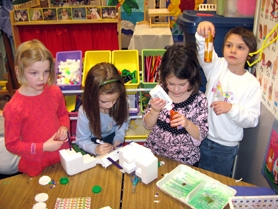by: Barbara Sherman, LET IT SNOW! — Making treasures out of Styrofoam (which kids pretend is snow) are Deer Creek Elementary kindergartners Molly Russell (left), Amelia Elliot, Ivy Saylor and Cora McKay, whose class is currently studying winter weather.