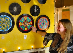 by: Merry MacKinnon, Southeast Portland resident Christine Claringbold creates hand-painted bracelets, mirrors, clocks and bowls out of old vinyl records. She also teaches PTA-sponsored Cool Schools classes to some of Duniway Elementary School's children.