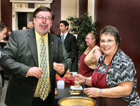 by: David F. Ashton, Richard Kiely, past S.E. Works board member and owner of Homerun Graphics, tastes the Apple Cheddar Cheese Soup (winner of a Celebrity's Choice Award) made by Patty Park of Portland Specialty Banking Co., at the organization's 10th Annual Celebration and 7th annual Soup Cook-off event.