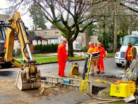by: Merry MacKinnon, Maintenance workers from Portland's Bureau of Environmental Services (B.E.S.) repaired a sewer line in Woodstock after tree roots intruded into the pipe. Video inspections often reveal such problems.