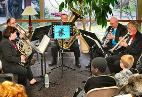 "by: David F. Ashton, The Johnson Creek Brass play ""standards"" and classical music for the standing-room-only audience at Milwaukie's Ledding Library."