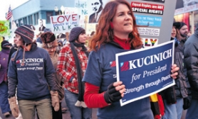 by:  JIM CLARK, Dennis Kucinich supporters Alison Gaylor (left) and Emily Hirsch (with sign) march in a Martin Luther King Jr. Day event last week. Kucinich, a Democratic congressman from Ohio, pulled the plug on his presidential campaign days later.