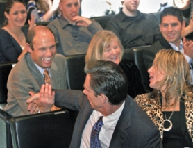 by: L.E. BASKOW, Oregon State football coach Mike Riley (left) congratulates Beaver baseball coach Pat Casey after Casey won his third straight Slats Gill Sportsperson of the Year Award. Riley's wife, Dee, and former OSU and current Boston Red Sox star Jacoby Ellsbury are to his left. Casey is sitting with wife, Susan.