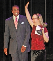 by: L.E. BASKOW, Amelia Abel of Sheldon High shared the stage with host Ahmad Rashad after winning the Lou Burge Special Olympics Athlete of the Year award.