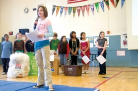 by: Carole Archer, Catherine Spaulding, a fifth-grader at Fairview Elementary School, speaks at an assembly Friday, Jan. 25, to honor the school's environmental efforts.