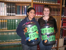 by: , Lake Oswego High School student Shailini Pandya, left, and Lakeridge High School student Amy Guillotte, right, organized the Pennies for Peace fundraising drive for the Central Asia Institute as part of Lake Oswego Reads. The students presented assemblies, distributed fliers, created displays and delivered the decorated jugs to the nine elementary schools where the drive is taking place. It wraps up Friday and a check will be presented to Greg Mortenson, CAI executive director, Wednesday at LOHS.