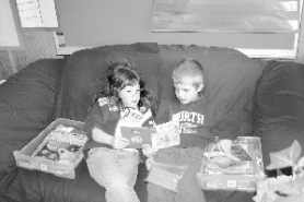 "by: Garth Guibord, First grader Sydney Hutchings, 6, left, reads the book ""Up in a Tree"" to her classmate, 6-year-old Cooper Vincent."