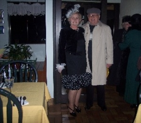 by: contributed photo, Members of the First Friday Diners Club dressed their part for a special Titanic-themed meal in January, including Patricia and El Loe.
