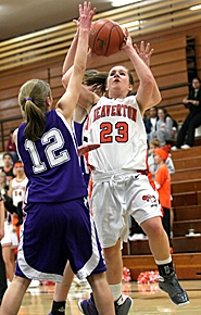 by: MILES VANCE, IN TRAFFIC — Beaverton junior guard Jenny McKee goes up over Sunset freshman Katherine Salness for a shot during her team's 45-41 Metro League victory last Thursday at Beaverton High School.