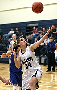 by: MILES VANCE, I GOT IT — Valley Catholic senior post Kate Emery stretches for a rebound during her team's 52-28 victory over Amity on Friday night at Valley Catholic High School.