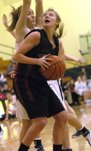 by: DAN BROOD, STRONG IN THE POST — Tualatin High School sophomore Julie Arndorfer looks to go up to the basket against Canby's Alena Evans during Tuesday's game.