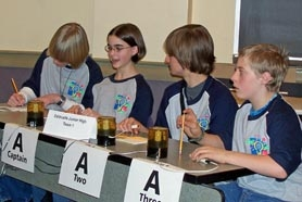 by: Mary Ann Bugni, Estacada Team 1 in a morning Round Robin match - (L to R) Shawn Moyer, Captain Andrea Bugni, Dylan Ortega, and Caleb Wiles.